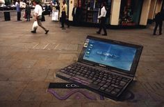 the laptop is drawn onto the sidewalk.  Looks real, huh.