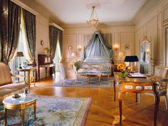 Rooms in a palette of light colors and bright accents have period-style furnishings as well as views... - Courtesy Le Meurice