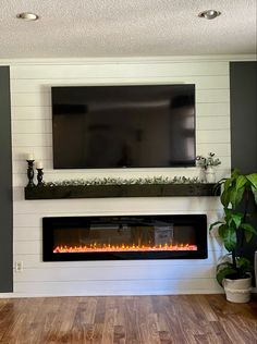 Living room redo with shiplap and electric fireplace insert Fireplace Tv Wall, Build A Fireplace, Basement Fireplace, Fireplace Remodel, Fireplace Design, Shiplap Fireplace, Fireplace Inserts, Fireplace Ideas, Fireplace With Bookshelves