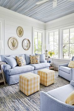 Our Best Living Room Wall Decor Ideas   In the living room of the Jacksonville, Florida, river house, designer Stephanie Jarvis hung a trio of brass botanicals found at the Marburger Farm Antique Show in Texas. #decorideas #homedecor #southernliving