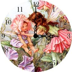 """Garden Fairy Girls Wall Clock by Vintage Artwork. $41.95. Usually Ships in 1 week10.5"""" DiameterAdd a splash of color to your girl's room or nursery with the Garden Fairy Girls Wall Clock which features a color palette of pink and purple. Enjoy every minute of your kid's room or nursery with this enchanting vintage wall clock! This beautiful vintage inspired clock will be cherished for years to come in your child's playroom or bedroom. Features of this wall clock inclu..."""