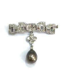 An art Deco'diamonds brooch with a black natural drop pearl www.narai.gr
