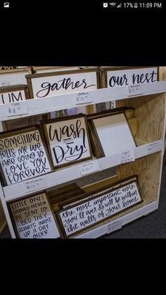 Wood signs on displayed on shelves craft booth displays, craft show booths, craft show Craft Show Table, Craft Show Booths, Craft Booth Displays, Craft Show Ideas, Retail Displays, Shop Displays, Jewelry Displays, Merchandising Displays, Window Displays