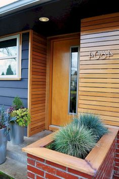 11 Cedar Siding Midcentury Entry and Brick Planter Cedar Concrete Paving Design Build Facade Design Front Stoop Grasses Horizontal Slat House Numbers Mid Century Modern Pacific Northwest Portland Succulents Wood Front Door Wood Siding Cedar Siding, Wood Siding, Exterior Siding, Barn Siding, Exterior Paint, Paving Design, Facade Design, Exterior Design, Farmhouse Sheds
