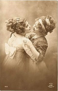Edwardian Ladies cuddle for the Camera at a Paris Studio - early 1900s