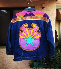 Psychedelic Arizona flag with lasso border and southwest desert scene painted on denim jacket by @bleudoor on Instagram