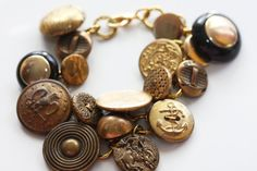 Sold! Gold, Brass, Yellow and Black Shiny Upcycled Vintage Button History Charm Bracelet by CinnamonandSilver, $20.00
