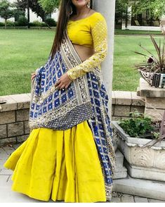 Yellow Annus Creation Lehenga with blue bandhani dupatta. Indian Fashion Dresses, Indian Gowns Dresses, Indian Bridal Fashion, Indian Bridal Wear, Indian Designer Outfits, Indian Outfits, Indian Wear, Chaniya Choli Designer, Designer Bridal Lehenga
