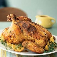 Roasted Chicken with Lemons and Thyme - Paprika, lemon, and thyme lend this simple roast chicken traditional Sephardic flavor. Substitute oregano for thyme, if desired. Garnish with fresh lemon slices or roasted lemon wedges. (To roast, add lemons to the roasting rack during the last 20 minutes of  the cooking time.).  Print this recipe at AmericanFamily.com.