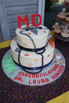 Medical Doctor Cake 2 . I renamed this pin, because my original M.D. cake has been repinned so many times.  This one was for my daughter, and the original pin was the inspiration.