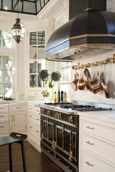 Love this range and hood The Glam Pad: I'm Dreaming of a White Kitchen