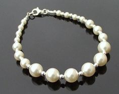 This is a beautiful classically styled bracelet of graduated ivory Swarovski pearls (also available in white) interspaced with Sterling Silver beads. Standard inch length and finished with a Sterling Silver clasp. Wedding Earrings, Wedding Jewelry, Wedding Bracelets, Swarovski Pearls, Silver Pearls, Pearl Bracelet, Pearl Necklace, Sterling Silver Bracelets, Wedding Accessories