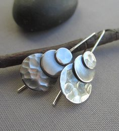 A personal favorite from my Etsy shop https://www.etsy.com/listing/251983168/metalsmith-earrings-hammered-silver