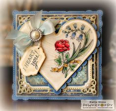 really nice card. Love the heart shape with to curved flowers & the flower centered in the middle.