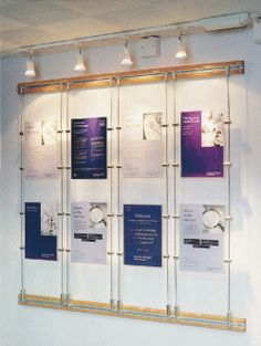 sign panels suspended by architectural rod display system