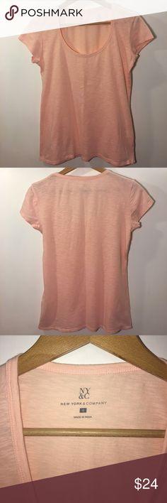 NY&C Peach-Pink Scoop Neck T-shirt Small New York & Company. Pinkish-peach color. Scoop neck. Short sleeve. Women's small. India. 100% Cotton. New York & Company Tops Tees - Short Sleeve