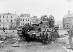 German troops examine abandoned British Churchill tank from the Calgary Regiment; After Dieppe Raid; 1942