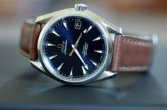 "Omega Seamaster Aqua Terra ""Skyfall"" w/blue dial and a leather strap. The best watch you can own if you only own one watch."