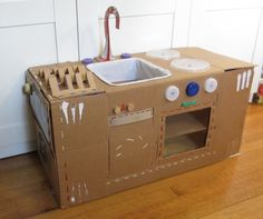 Repurposed/recycled folding cardboard play kitchen.