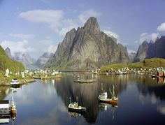 Boats steer through a fjord in the Lofoten Islands off the northwestern coast of Norway. The islands lie entirely within the Arctic Circle. Wonderful Places, Great Places, Beautiful Places, Places To Travel, Travel Destinations, Places To Visit, Land Of Midnight Sun, Lofoten Islands Norway, Les Fjords