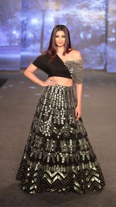 Beautiful Lehenga with modern blouse. Superb embellishments of embroidery and gota work with traditional embroidery. Party Wear Indian Dresses, Designer Party Wear Dresses, Indian Gowns Dresses, Indian Bridal Outfits, Indian Fashion Dresses, Dress Indian Style, Indian Designer Outfits, Indian Fashion Modern, Indian Wedding Gowns