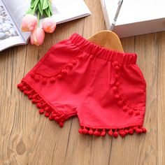 * Floral print<br /> * Tassels design<br /> * Breathable and comfy<br /> * Material: Cotton<br /> * Machine wash, tumble dry<br /> * Include: 1 top, 1 bottom<br /> * Imported Kids Outfits Girls, Toddler Girl Outfits, Baby Outfits, Little Girl Dresses, Toddler Girl Shorts, Baby Girl Fashion, Kids Fashion, Short Niña, Short Set