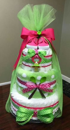 Hot pink and green diaper cake. Baby girl shower gift. So cute!!! Check out my Facebook page Simply Showers for more pics and orders. https://m.facebook.com/adorablegifts