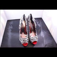 "Zebra print peep toe heels❤️ Zebra print peep toe heels with bows on the side and red heels. Heel is about 4.5"". Platform about 1.0"". Never worn! Paris Hilton Shoes Heels"