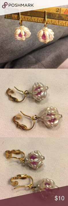 """Vintage pink bead clip-on earrings Vintage clip-on earrings with center pink bead surrounded with white pearlescent """"cage"""". About 1"""" drop. In excellent shape. Lightweight plastic beads. Vintage Jewelry Earrings"""