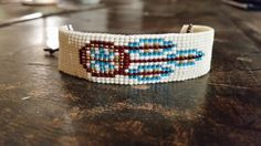 Loom beaded bracelet with waxed cord / Beaded bracelet made with Miyuki delica beads / Native inspired bracelet Loom Bracelet Patterns, Bead Loom Patterns, Beaded Jewelry Patterns, Beading Patterns, Tribal Bracelets, Bead Loom Bracelets, Bracelet Tiffany, Bead Loom Designs, Seed Bead Crafts