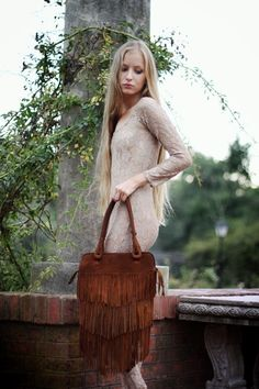 On Sale was 170 usd //Fringe Brown  Leather Bag // Made to order  //. $140.00, via Etsy. It's pretty cute... think it would go out of style fast?