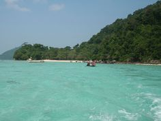 Looking for an island getaway in Thailand -- that's not trampled by tourists? Consider this pristine island in Thailand's Mu Koh Surin National Park. You won't find high-end hotels or crowds here -- just small bungalows and camping under the stars. Vacation Destinations, Vacation Spots, Vacations, The Places Youll Go, Places To See, Ocean Pictures, Ocean Pics, Bucket List Holidays, Need A Vacation