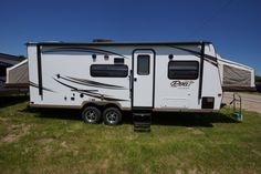 """AWESOME HYBRID FAMILY TRAVEL TRAILER!!!  2016 Forest River Rockwood Roo 233S This RV is accommodating for families with 3 slide-out beds and a dinette bed, for a sleeping capacity of 8 people! Everyone will enjoy hot showers after a long day with a great quick-recovery water heater! The 233S is 25'3"""" long, weighs 4,786 dry, and has a 43-28-28 gallon holding tank capacity. Give our Rockwood Roo expert Jacob Goodyear a call 989-860-2620 for pricing and more information."""