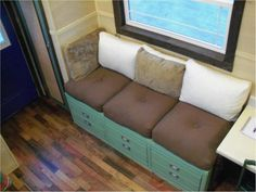 I love the us of a desk/dresser as a base for the couch! Great upcycle idea!