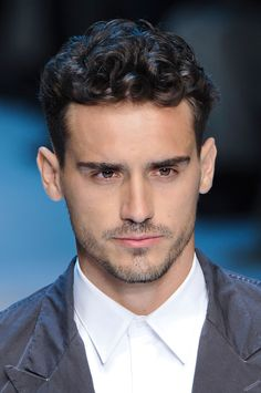 mens short curly hair Short curls hairstyle with short sides on the Dolce & Gabbana men's spring 2012 catwalk