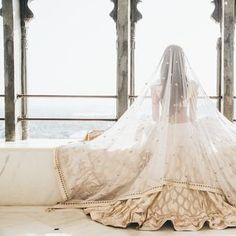The bride in Anita Dongre on her wedding day - Indian wedding - destination wedding - matha patti - style by susmita - lehenga - Udaipur