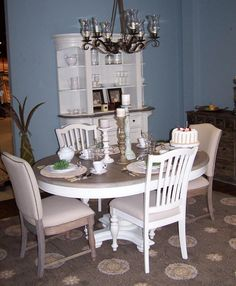 "Riverside Dining Set of 5  ""Coventry"" Collection in Driftwood/Dover White.  The table is 48"" Diameter with an18"" Leaf.  The area rugs is by O.W. Sphinx from the Milano Collection."
