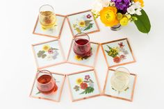 All you need to make these gorgeous coasters is 4 x 4-inch glass tiles, dried pressed flowers, copper tape and E6000 glue.