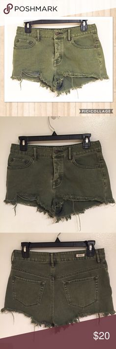 Brandy Melville High Waisted Distressed Shorts Brandy Melville olive green high waisted distressed shorts. Size 28. Button fly.  #brandy #melville #brandymelville #olive #green #highwaisted #distressed #shorts #trendy #button #buttonfly #spring #summer #punkydoodle  No modeling Smoke free home I do discount bundles Brandy Melville Shorts