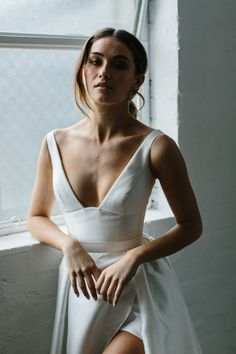 Taryn Camille is a simple, modern A-line wedding dress with a slit and a plunging open v-neck. This customizable, nontraditional wedding dress has pockets. Karen Willis Holmes, Bridal Gowns, Wedding Gowns, Lace Wedding, Dress Vestidos, Looks Vintage, The Dress, Marie, Dream Wedding