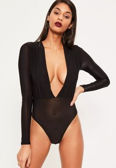 Sexy but chic, this piece is at the top of our lust list, with long sleeves and a deep plunge V neck it's a sure fire to ensure all eyes are on you. Wear this black bodysuit with a faux leather mini skirt and strappy lace up heels to get a ...
