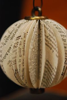 Old Book Page Ornaments 2. Punch out about 30 circles from the book pages; fold in half, glue each one to the next; glue the first one to the last to form circular ornament. For center, I glued in a rusty eye bolt in the top and a fairly large bolt in the bottom.
