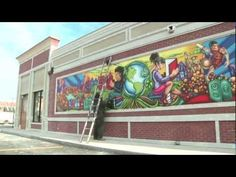 Mural in Minutes: Time lapse video of artist Rahmaan Statik creating the Global Intellect mural at the 87th Street Garrett Popcorn Shop in Chicago.