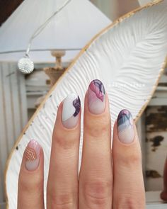 Romantic pinks and blues in a modern artwork inspired nail art.