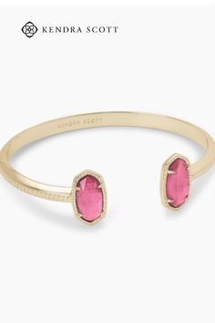 A dainty pinch cuff bookended with our signature oval stones, the Elton Gold Cuff Bracelet in Berry Illusion is a stack staple. This beautifully designed Gold cuff bracelet is guaranteed to turn heads every time you wear it. No matter the size of your wrist, our Elton Cuff Bracelet is sure to fit you and your style.
