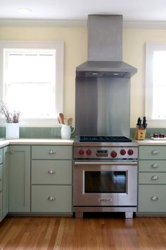 Love the darker shade of green on the cabinet structure with lighter green on drawer and cabinet faces.