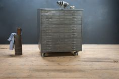 USA, 1940s, Vintage Industrial Hamilton 6820 Artist/Architect Flat File Drawing Cabinet/Chest. All Steel Construction. Highly Functional, Smooth Rolling Drawers. Consists of 3 Modular Cabinets of 5 Drawers each. Solid and Sturdy. The Cabinet sit on a Set of Large Industrial Swivel Casters. The exterior has is a Gun Metal Grey with a Worn Patina, some Scratches and Dings, Consistent with Age. The Interior of the Drawers are Very Clean.    factory20.com