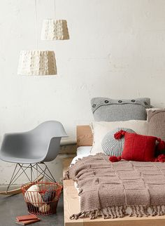 I normally hate the look of knitted/crocheted things, but these pillows and throw are really cute. Also like the rocker.
