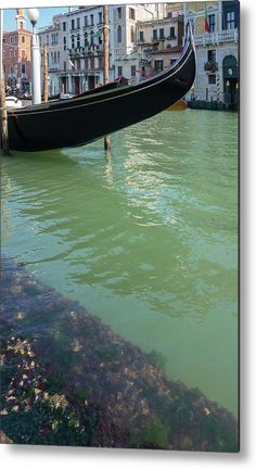 Venetian Water Metal Print by Marina Usmanskaya for home decor.    All metal prints are professionally printed, packaged, and shipped within 3 - 4 business days and delivered ready-to-hang on your wall. Choose from multiple sizes and mounting options.  Venetian water of unusual turquoise color on the embankment near the gondolier station  #MarinaUsmanskayaFineArtPhotography #HomeDecor #FineArtPrints #Venice #Water #ArtForHome #Gondola