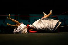 Cholita wrestler Martha La Altena (right) fights with a male wrestler dressed as a Cholita during the 'Titans of the Ring' wrestling group's Sunday performance at El Alto's Multifunctional Centre, El Alto, Bolivia. Photo by Lisa Wiltse, from Bolivia's Cholita Wrestlers